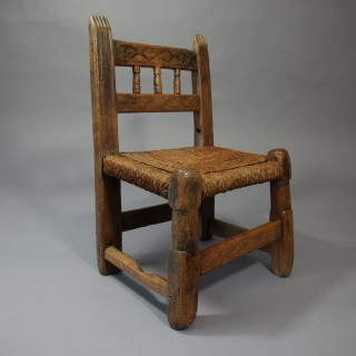 Rare folk art 18th century pine spindle back child's chair