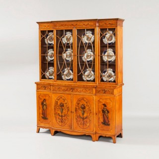 An Antique Satinwood Library Bookcase in the manner of Sheraton