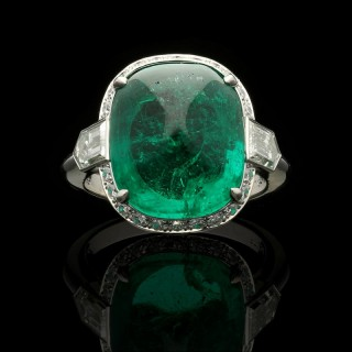 Hancocks 8.59ct Sugar loaf Cabochon Colombian Emerald  with Diamond halo  Platinum Ring