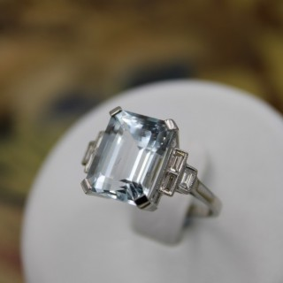 A very beautiful Platinum (marked) Aquamarine of approximately 8 Carats and Diamond stepped shouldered Ring. Mid - late 20th Century.