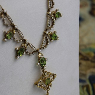An extremely beautiful 15ct Yellow Gold (marked), Peridot & Seed Pearl Festoon Necklace, with a matching Quatrefoil style detachable Pendant Brooch, English Circa  1890 - 1910.