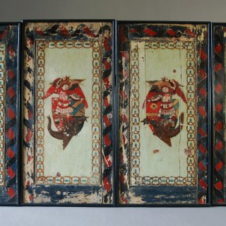A late 18thc set of twelve highly decorative naively painted pine wooden panels