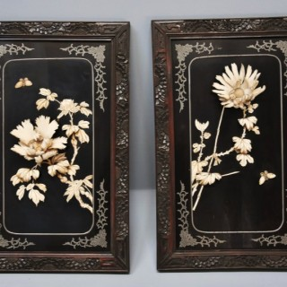 Pair of highly decorative late 19thc black lacquered panels with carved floral decoration