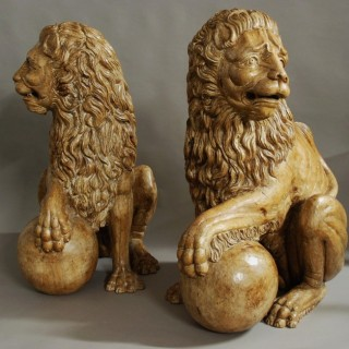 Magnificent pair of life size highly decorative 19thc Italian carved pine Medici lions