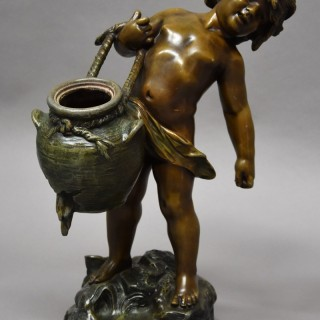 19thc French patinated bronzed spelter figure of young male water carrier signed Auguste Moreau
