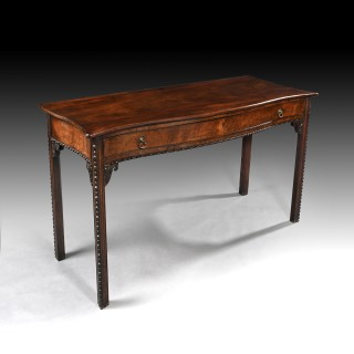 George III Mahogany Serpentine Side Table in the Manner of Wright & Elwick.