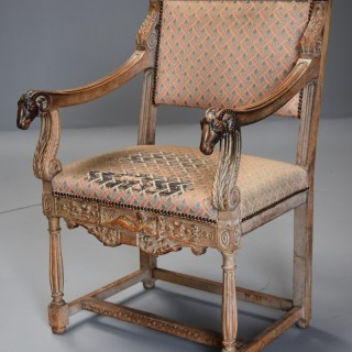 Late 19thc highly decorative French limed oak armchair in the Renaissance style