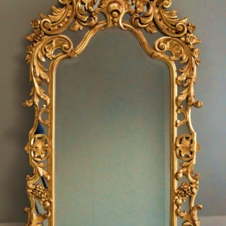Large mid 19th century Italian giltwood mirror with arched top in excellent condition
