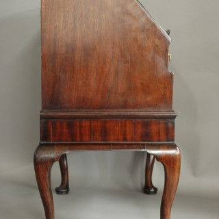Rare & elegant mid 18th century mahogany bureau on stand of small proportions