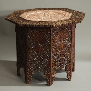 Late 19th century Indian octagonal hardwood table with decorative copper inset top