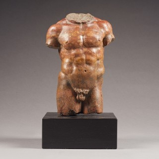 A Small Grand Tour Torso in Red Marble, After the Antique