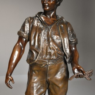 French late 19thc large bronzed spelter figure of a farm labourer  signed F.Milliot