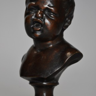 A charming fine quality late 19th century bronze bust of young child of small proportions