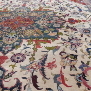 Fine Tabriz carpet, signed 'Benlian'