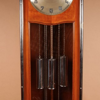 An Art Deco Modernist Junghans Teak/Amaranth And Chrome Very Stylish Westminster Longcase Clock. Circa 1940.