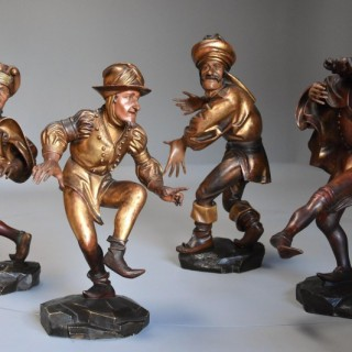 Superb set of four 19thc giltwood & polychrome carved wooden figures of Medieval Morris Men after the original set by Erasmus Grasser in 1480