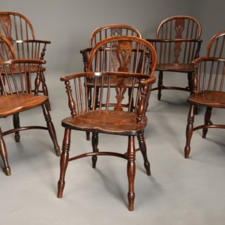 Mid 19th century well matched set of six yew wood low back Windsor armchairs