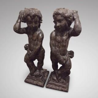 Pair of carved oak cherubs