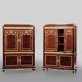 A Fine Pair of Louis XVI Style Gilt Bronze Mounted Mahogany Cabinets  By Paul Sormani