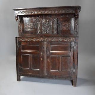 Wonderful example of a mid 17th century carved oak press cupboard with superb original patina