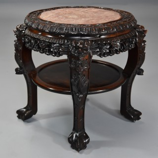Late 19th century Chinese hardwood circular pot stand or low table