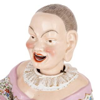 Pair of porcelain nodding head figurines by Ernst Bohne Söhne