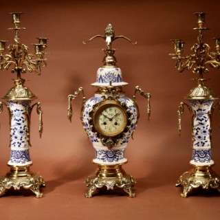 "An Impressive Blue And White  ""Dutch Delft"" And Brass Art Nouveau Clock Garniture. French Circa 1900."