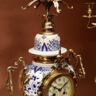 "An Impressive Blue And White  ""Dutch Delft"" And Brass Art Nouveau Clock Garniture. French Circa 1900."
