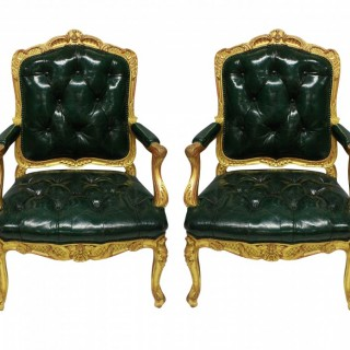 A FINE PAIR OF REGENCE GILTWOOD FAUTEUILS IN LEATHER