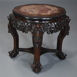 Late 19th century Chinese hardwood pot stand with shaped marble inset top
