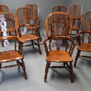 Superb rare set of eight 19th century burr yew broad arm high back Windsor armchairs of superb patina