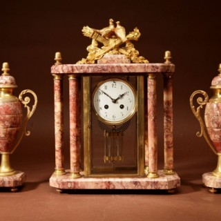 A Very Decorative French Gilded Brass And Marble Clock Garniture.
