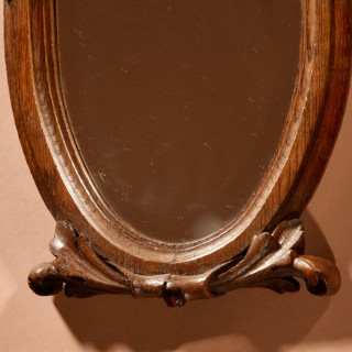 A Decorative Carved Oak Oval Mirror, Louise seize Style, circa 1900