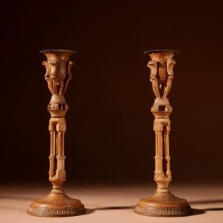 A pair of very stylish unusual very fine carved and engraved walnut candlesticks.