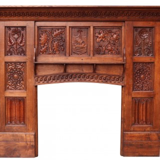 An English Arts & Crafts Style Carved Oak Fireplace