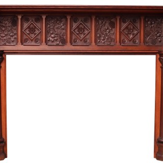 An English Arts and Crafts Style Carved Oak Fireplace