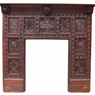 An English Jacobean Revival Carved Oak Fireplace