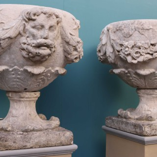 A Pair of 18th Century English Carved Limestone Urns