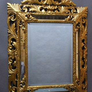 Large late 19thc Italian superbly carved giltwood cushion mirror, probably Florentine