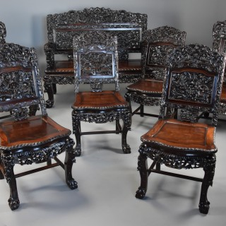 Superb quality late 19th century Chinese profusely carved padouk seven piece suite
