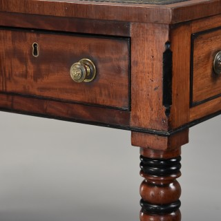 Large early 19th century Regency six drawer writing table of fine, faded patina