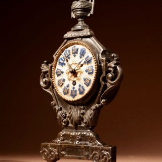 A French Cast Iron And Brass Rare Mantel Clock, Circa 1870.