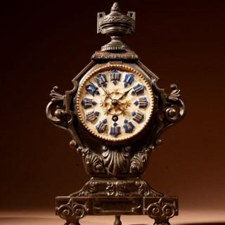 A French Cast Iron And Brass Rare Mantel Clock, Circa 1870.