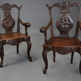 Pair of highly decorative 19thc walnut open armchairs of Chinese influence in the 18thc style