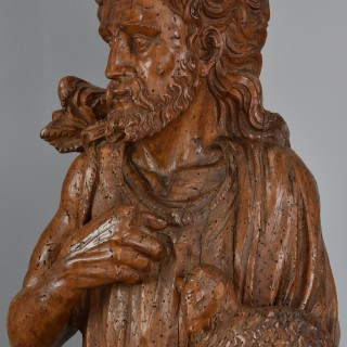 Large Continental mid 16th century carved limewood figure of St. John the Baptist