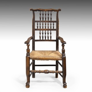 An Attractive Mid 19th Century Elm Spindleback Armchair