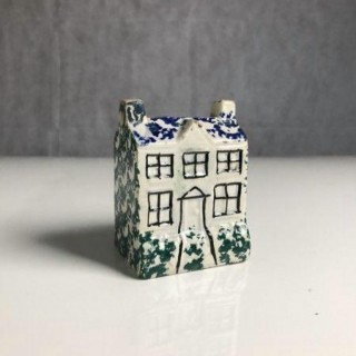 Small pottery money box in the form of a cottage