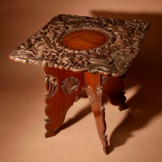 An original very fine carved Indian folding table made in Srinagar circa 1900/1920