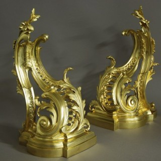 Fine quality pair of late 19thc French Rococo style ormolu chenets (or fire dogs)