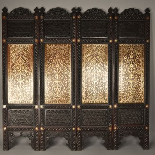 Fine quality 19thc Anglo Indian profusely carved padouk & brass inlaid four fold screen from Northern India